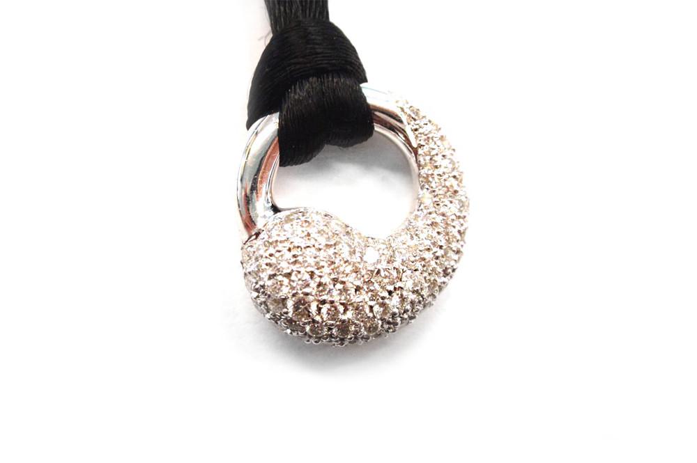 Open circle pendant with multi round brilliant diamonds pave set